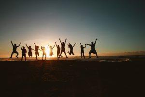 backlit-teens-jumping